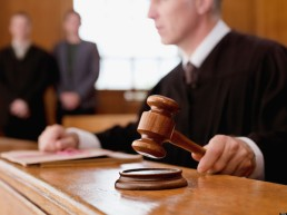 Judge holding gavel in courtroom. Image shot 2010. Exact date unknown.